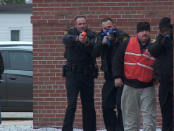 Officer William Old, III (second from left, holding blue training prop rifle) with other responders on Feb. 11. (Photo by Mike Gooding, WVEC TV-13)