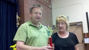 Claudia Cary, SACL's volunteer liaison to Suburban Park Elementary presents SACL President Kevin Janney an Outstanding Partners in Education award for the civic league for the 2011-2012 school year.