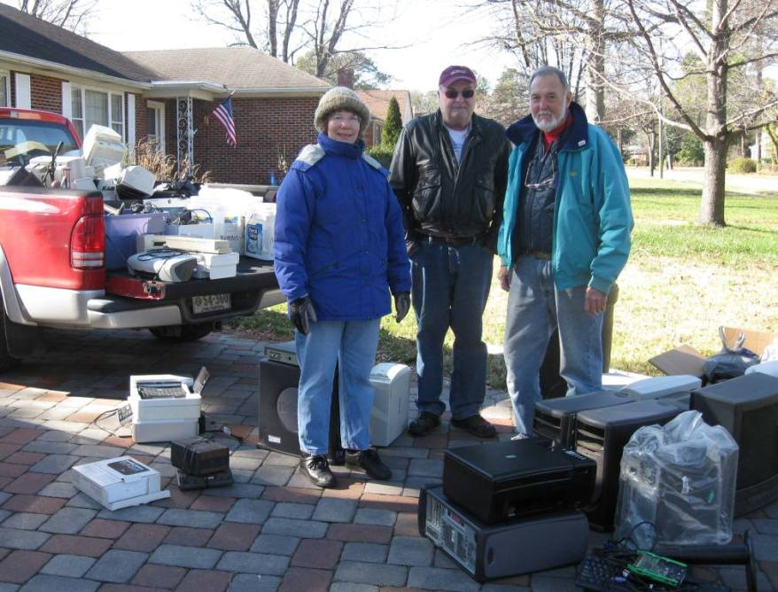 Karen Mayne (left) stands with Richard and Jeff Turner after the Turners drop off household electronics for recycling on Jan. 14th.