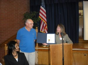Norfolk Police Crossing Guard Mike Waldron receives a certificate of appreciation from the Mayor at a special civic league meeting on May 11, 2009. If you've driven Thole Street mornings or afternoons on school days, you've seen his conscientious effort to get our kids safely to and from school. Slowing and stopping traffic at peak driving times is not an easy task.  Mike's word of caution for Thole Street drivers is slow down and watch out for our children.