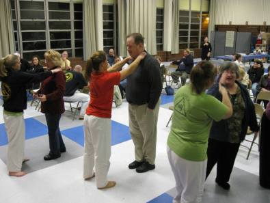 Instructors from Norfolk Karate Academy coach civic league members in self-defense moves at the January 9th, 2012 Suburban Acres Civic League Meeting.