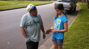 Cleanup volunteer Sara Richman explains the scutes and skeletal components of a turtle shell found in the Lafayette to Ray Kubick in Suburban Acres